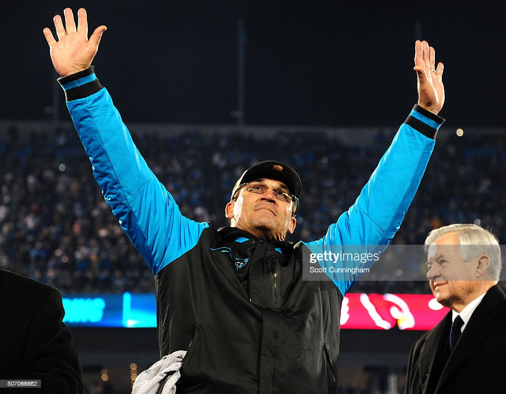 Head Coach Ron Rivera of the Carolina Panthers celebrates after the NFC Championship Game against the Arizona Cardinals at Bank Of America Stadium on...