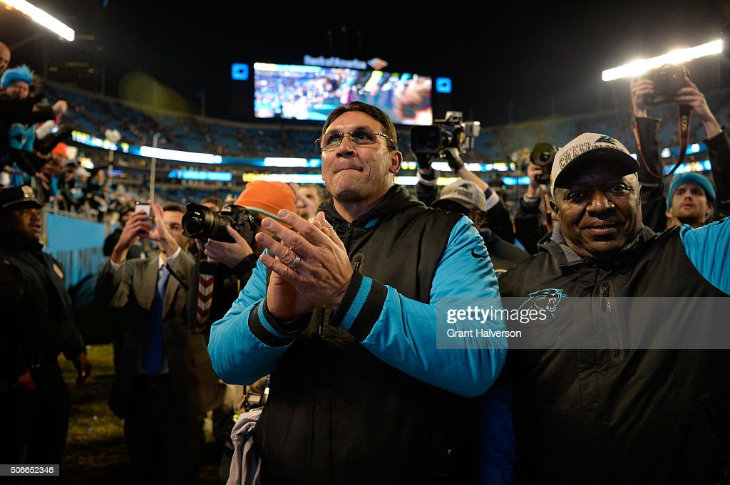 Head coach Ron Rivera of the Carolina Panthers celebrates defeating the Arizona Cardinals with a score of 49 to 15 to win the NFC Championship Game...