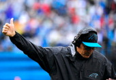 head coach Ron Rivera of the Carolina Panthers flashes a thumbsup during a win against the New Orleans Saints during their game at Bank of America...