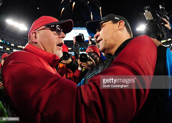 Head Coach Ron Rivera of the Carolina Panthers is congratulated by Head Coach Bruce Arians of the Arizona Cardinals after the NFC Championship Game...
