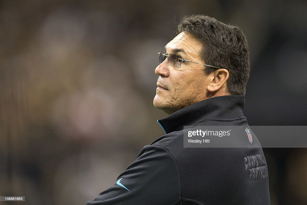 Head coach Ron Rivera of the Carolina Panthers looks on from the sideline during a game against the New Orleans Saints at Mercedes-Benz Superdome on December 30, 2012 in New Orleans, Louisiana. The Panthers defeated the Saints 44-38.