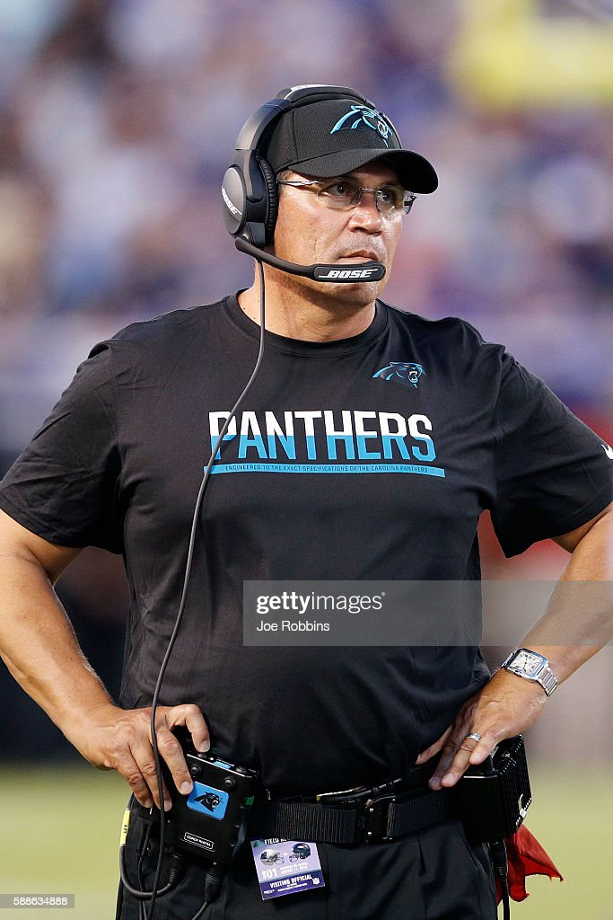 Head coach Ron Rivera of the Carolina Panthers looks on in the first quarter of a preseason NFL game against the Baltimore Ravens at MT Bank Stadium...