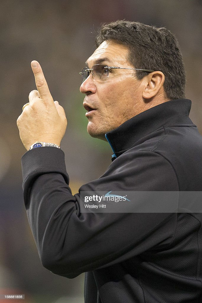 Head coach Ron Rivera of the Carolina Panthers points out something to an official during a game against the New Orleans Saints at Mercedes-Benz Superdome on December 30, 2012 in New Orleans, Louisiana. The Panthers defeated the Saints 44-38.