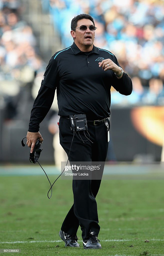 Head coach Ron Rivera of the Carolina Panthers runs onto the field against the Atlanta Falcons during their game at Bank of America Stadium on...