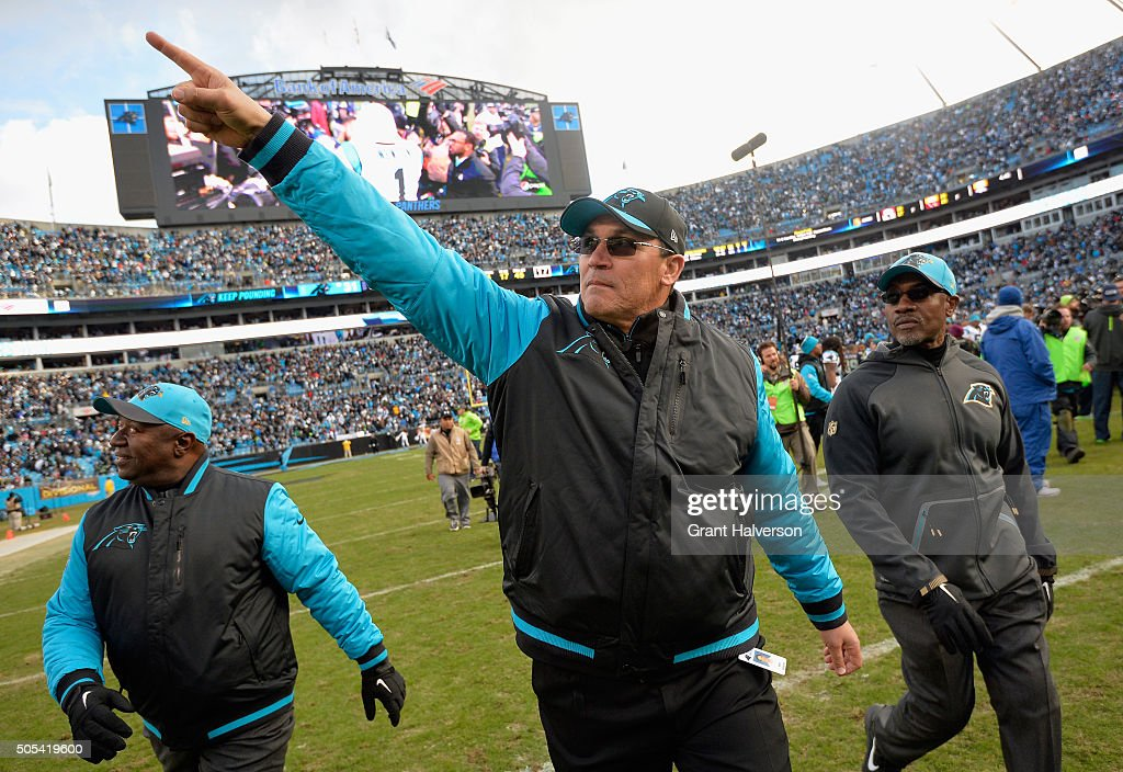 Head coach Ron Rivera of the Carolina Panthers salutes the crowd after defeating the Seattle Seahawks 3124 at the NFC Divisional Playoff Game at Bank...