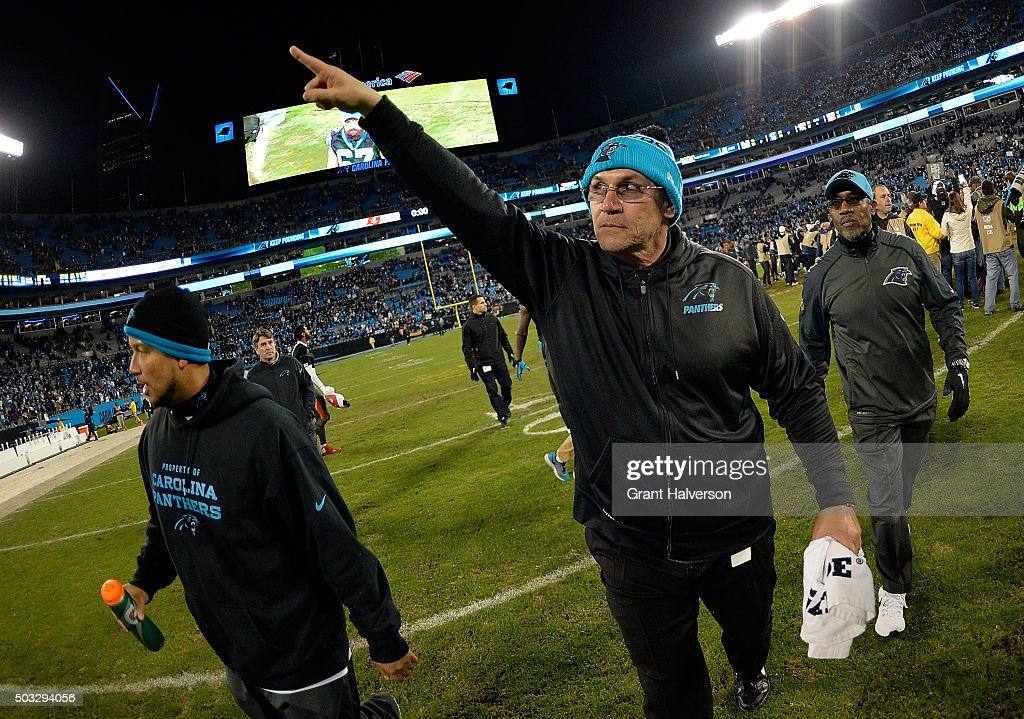 Head coach Ron Rivera of the Carolina Panthers salutes the fans as he leaves the field after a win against the Tampa Bay Buccaneers at Bank of...