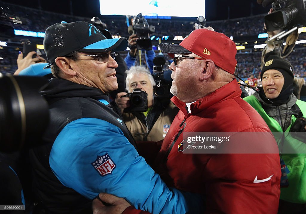 Head coach Ron Rivera of the Carolina Panthers shakes hands with head coach Bruce Arians of the Arizona Cardinals after the Carolina Panthers defeat...