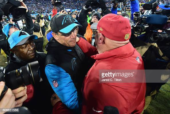 Head coach Ron Rivera of the Carolina Panthers shakes hands with head coach Bruce Arians of the Arizona Cardinals after the Carolina Panthers...