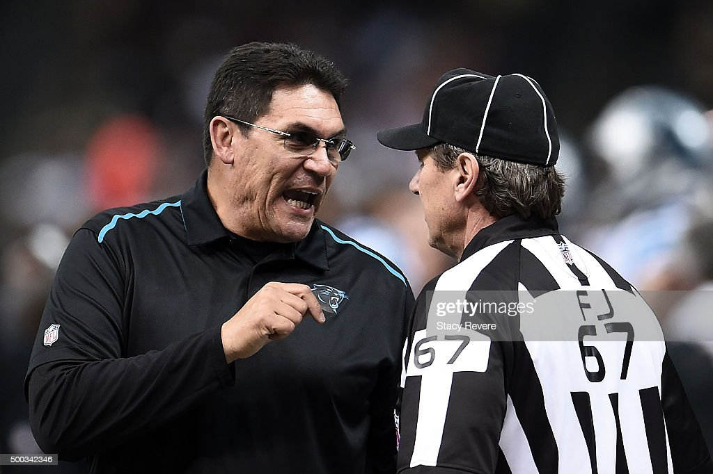 Head coach Ron Rivera of the Carolina Panthers speaks with field judge Doug Rosenbaum during a game against the New Orleans Saints at the...