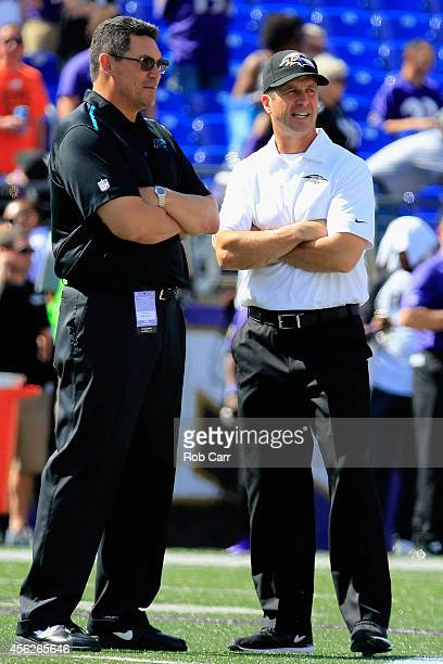 Head coach Ron Rivera of the Carolina Panthers speaks with head coach John Harbaugh of the Baltimore Ravens before a game at MT Bank Stadium on...