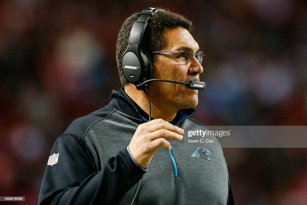 Head coach Ron Rivera of the Carolina Panthers stands on the sidelines in the first half against the Atlanta Falcons at the Georgia Dome on December...