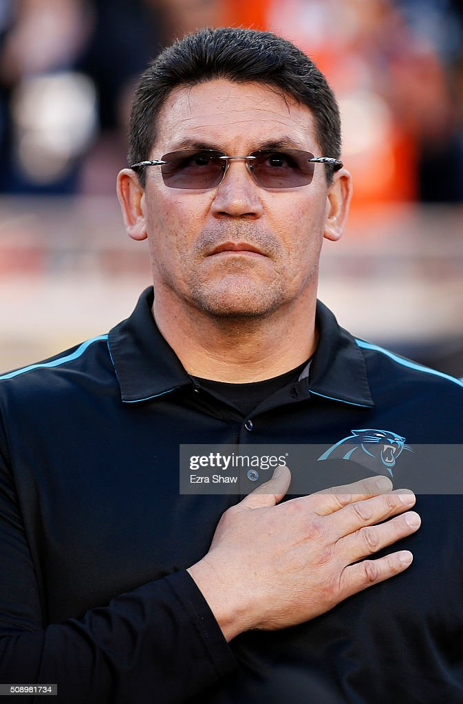 Head coach <a gi-track='captionPersonalityLinkClicked' href=/galleries/search?phrase=Ron+Rivera&family=editorial&specificpeople=590509 ng-click='$event.stopPropagation()'>Ron Rivera</a> of the Carolina Panthers stands on the sideline during the National Anthem prior to playing the Denver Broncos in Super Bowl 50 at Levi's Stadium on February 7, 2016 in Santa Clara, California.