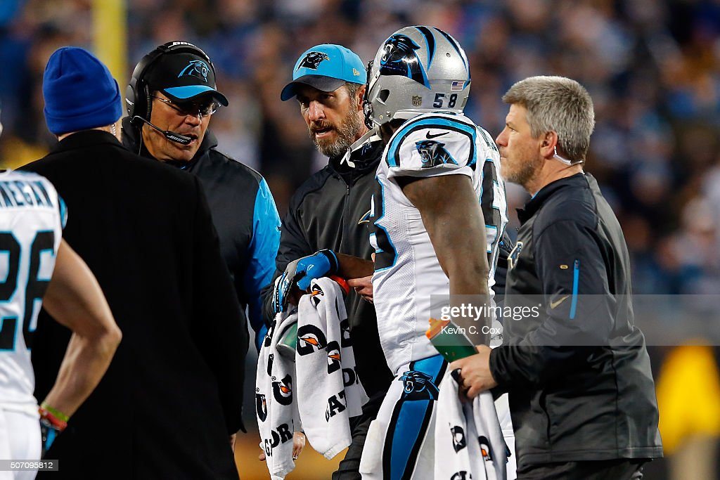 Head coach Ron Rivera of the Carolina Panthers talks with an injured Thomas Davis after a play against the Arizona Cardinals during the NFC...