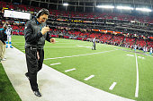 Head coach Ron Rivera of the Carolina Panthers walks on the sideline in the second half against the Atlanta Falcons at the Georgia Dome on December...