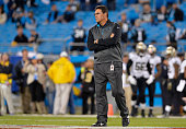 Head coach Ron Rivera of the Carolina Panthers watches his team warm up before a game against the New Orleans Saints at Bank of America Stadium on...