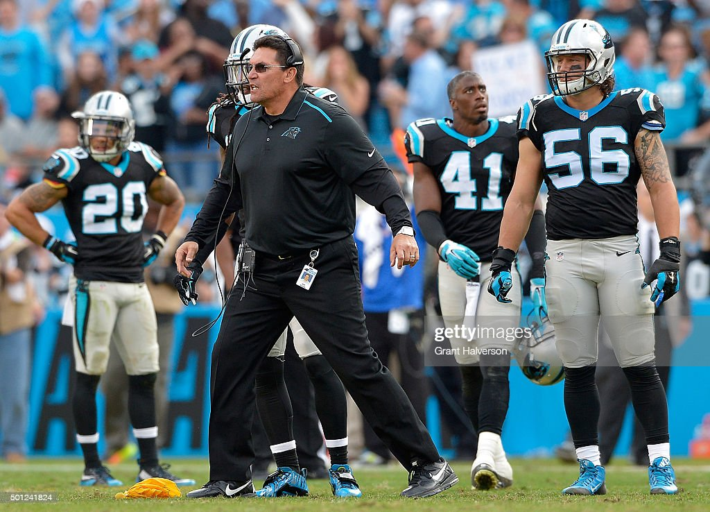 Head coach Ron Rivera of the Carolina Panthers yells for his team to get back to their sidelie after being call for unsportsmanlike conduct during...