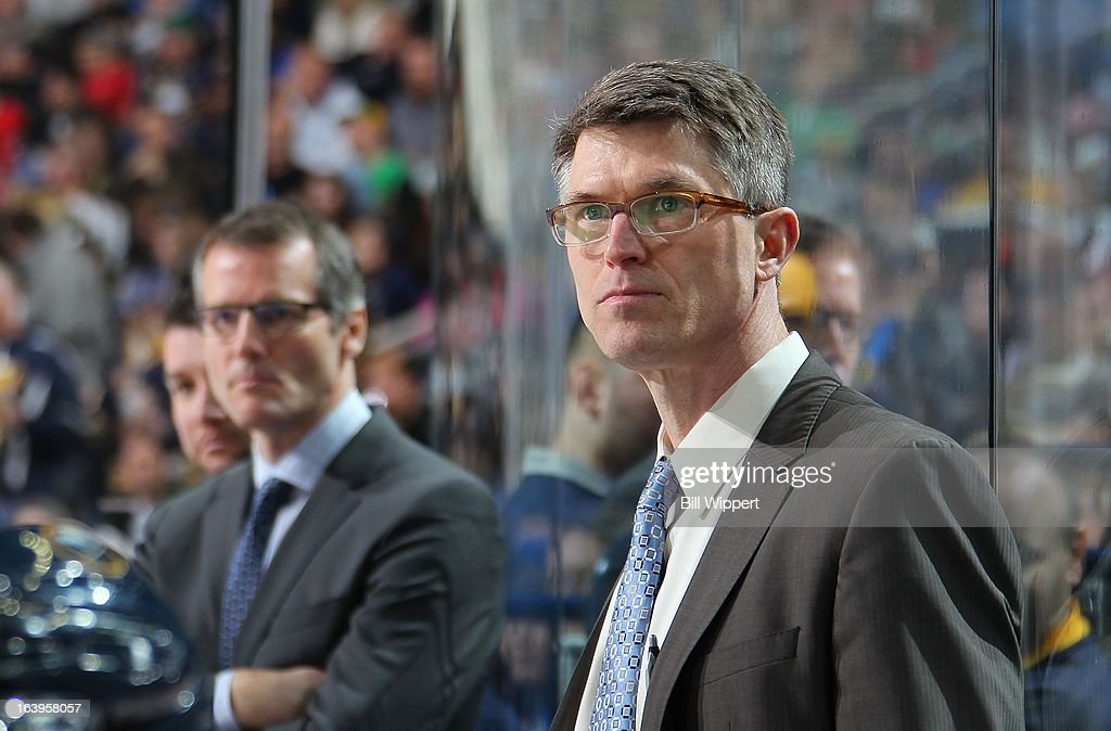 Head coach Ron Rolston and assistant coach James Patrick of the Buffalo Sabres watch the action against the Ottawa Senators on March 16 2013 at the...
