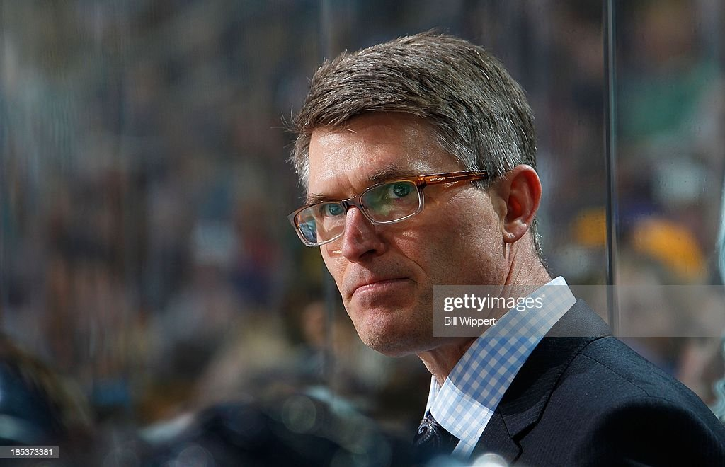 Head Coach Ron Rolston of the Buffalo Sabres keeps a close eye on the play of the game against the Colorado Avalanche on October 19, 2013 at the First Niagara Center in Buffalo, New York.