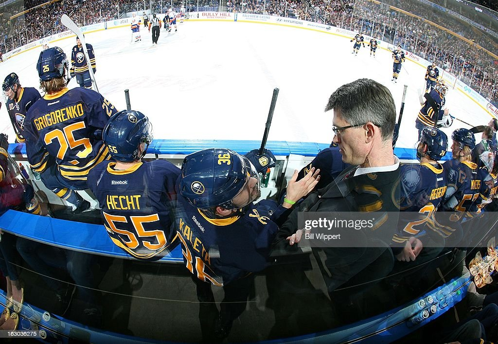 Head coach Ron Rolston of the Buffalo Sabres talks to players during their game against the New York Islanders on February 23, 2013 at the First Niagara Center in Buffalo, New York.