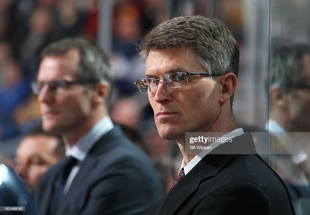 Head coach <a gi-track='captionPersonalityLinkClicked' href=/galleries/search?phrase=Ron+Rolston&family=editorial&specificpeople=5484106 ng-click='$event.stopPropagation()'>Ron Rolston</a> of the Buffalo Sabres watches their game against the New York Islanders on February 23, 2013 at the First Niagara Center in Buffalo, New York.