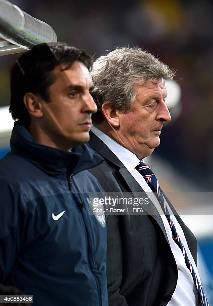 Head coach Roy Hodgson of England and assistant coach Gary Neville show their dejection after Uruguay's second goal during the 2014 FIFA World Cup...