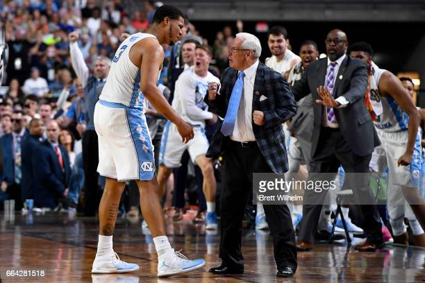 Head coach Roy Williams and Kennedy Meeks of the North Carolina Tar Heels celebrate during the 2017 NCAA Men's Final Four National Championship game...