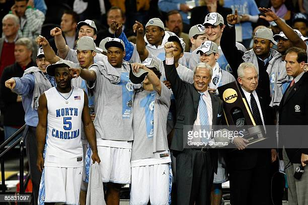 Head coach Roy Williams and the North Carolina Tar Heels celebrate with the championship trophy after defeating the Michigan State Spartans 8972...