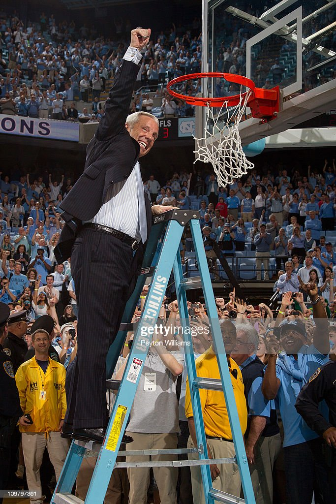 Head coach Roy Williams cuts down the nets after beating the Duke Blue Devils for the regular season ACC championship on March 05 2011 at the Dean E...