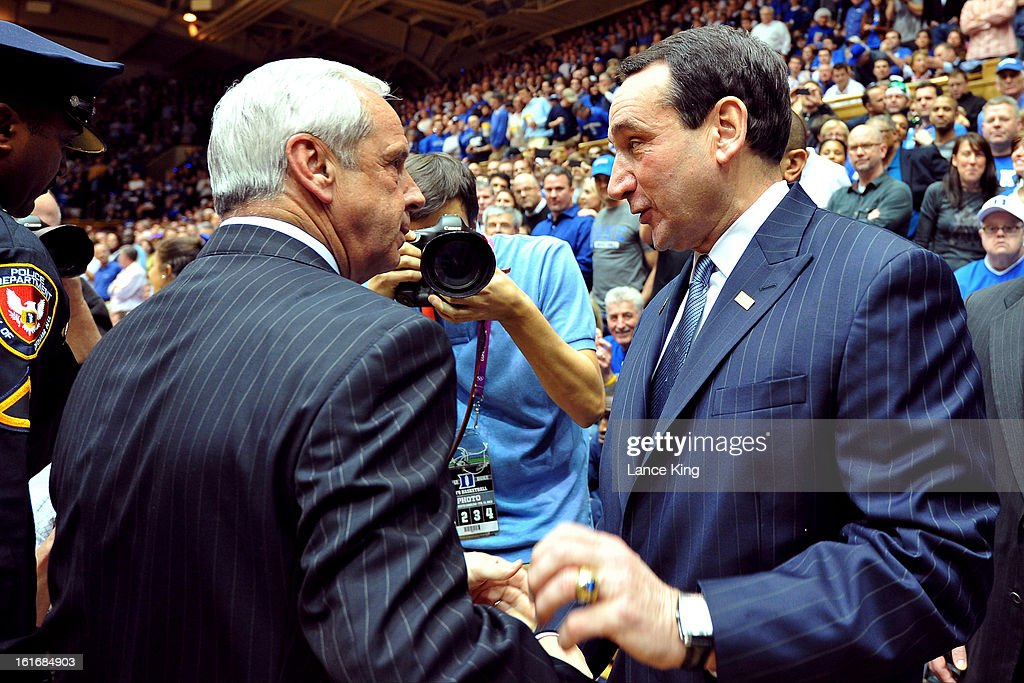 Head Coach Roy Williams (L) of the North Carolina Tar Heels and Head Coach Mike Krzyzewski (R) of the Duke Blue Devils talk prior to their game at Cameron Indoor Stadium on February 13, 2013 in Durham, North Carolina. Duke defeated North Carolina 73-68.