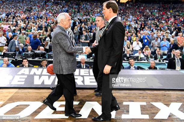 head coach Roy Williams of the North Carolina Tar Heels and head coach Dana Altman of the Oregon Ducks shake hands prior to tipoff during the 2017...