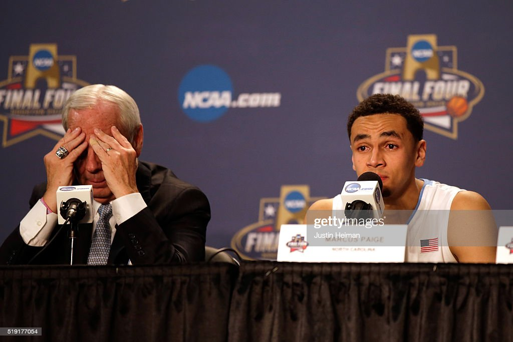Head coach Roy Williams of the North Carolina Tar Heels and Marcus Paige react after being defeated by the Villanova Wildcats 7774 in the 2016 NCAA...