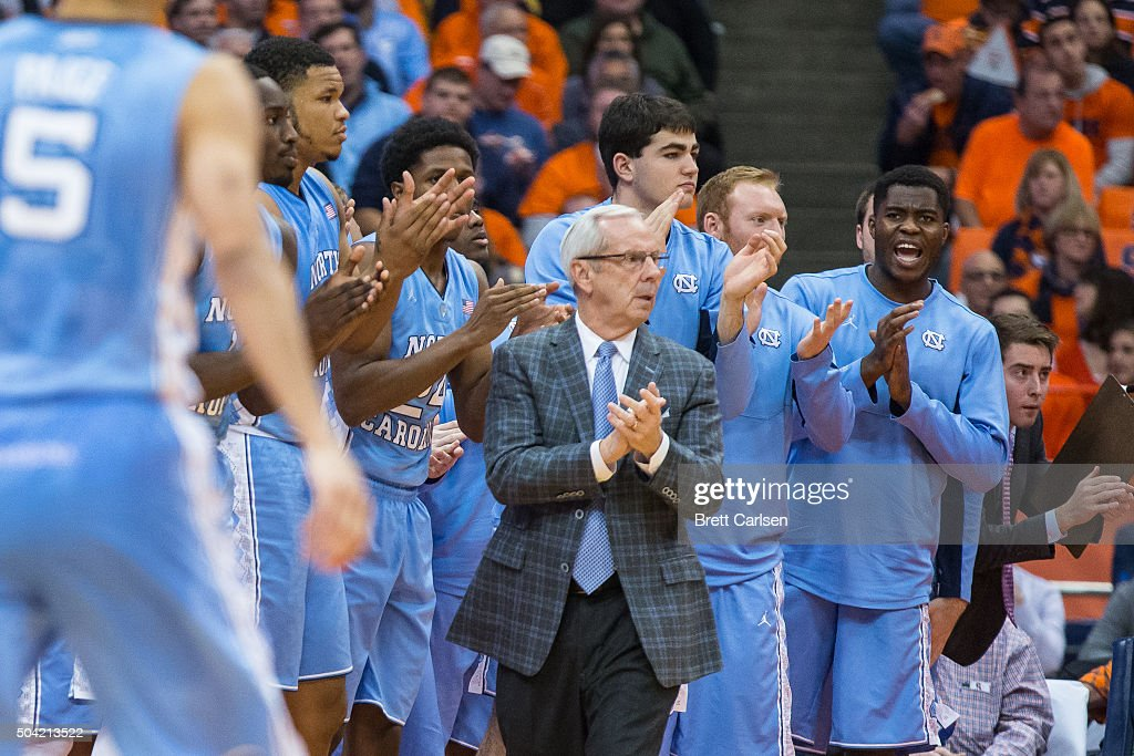 Head coach Roy Williams of the North Carolina Tar Heels applauds his team's efforts during the second half against the Syracuse Orange on January 9...