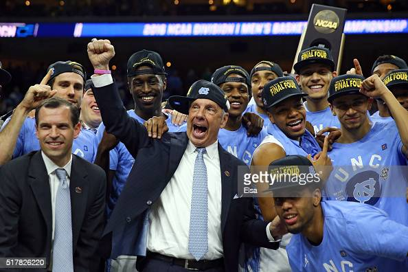 Head coach Roy Williams of the North Carolina Tar Heels celebrate with his team after defeating the Notre Dame Fighting Irish with a score of 74 to...