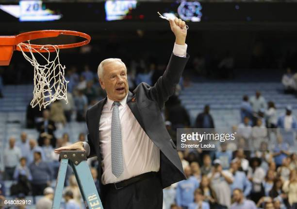 Head coach Roy Williams of the North Carolina Tar Heels celebrates as he cuts down the net after defeating the Duke Blue Devils 9083 to clinch the...