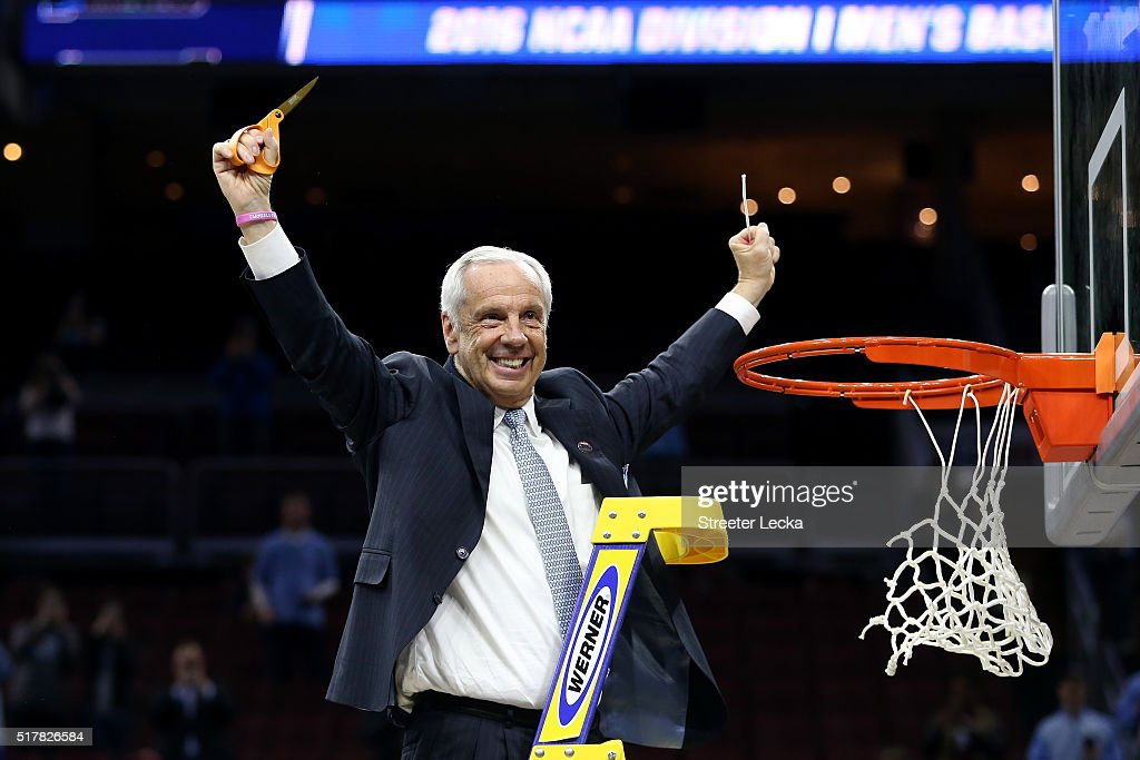 Head coach Roy Williams of the North Carolina Tar Heels celebrates by cutting down the net after defeating the Notre Dame Fighting Irish with a score of 74 to 88 in the 2016 NCAA Men's Basketball Tournament East Regional Final at Wells Fargo Center on March 27, 2016 in Philadelphia, Pennsylvania.