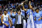 Head coach Roy Williams of the North Carolina Tar Heels celebrates with his team after defeating the Virginia Cavaliers 6157 to win the 2016 ACC...