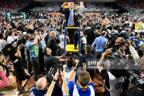 head coach Roy Williams of the North Carolina Tar Heels cuts the net after winning the championship during the 2017 NCAA Men's Final Four National...