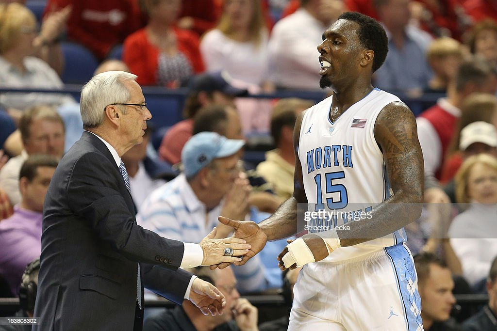 Head coach Roy Williams of the North Carolina Tar Heels gives P.J. Hairston #15 a five as he comes out of the game in the second half while taking on the Maryland Terrapins during the men's ACC Tournament semifinals at Greensboro Coliseum on March 16, 2013 in Greensboro, North Carolina.