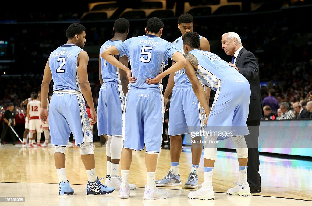 Head coach Roy Williams of the North Carolina Tar Heels huddles with his team during a break against the Wisconsin Badgers during the West Regional...