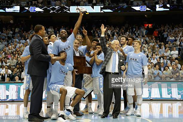 Head coach Roy Williams of the North Carolina Tar Heels is presented with a gift as he celebrates after his 800th career victory with a 8568 win over...