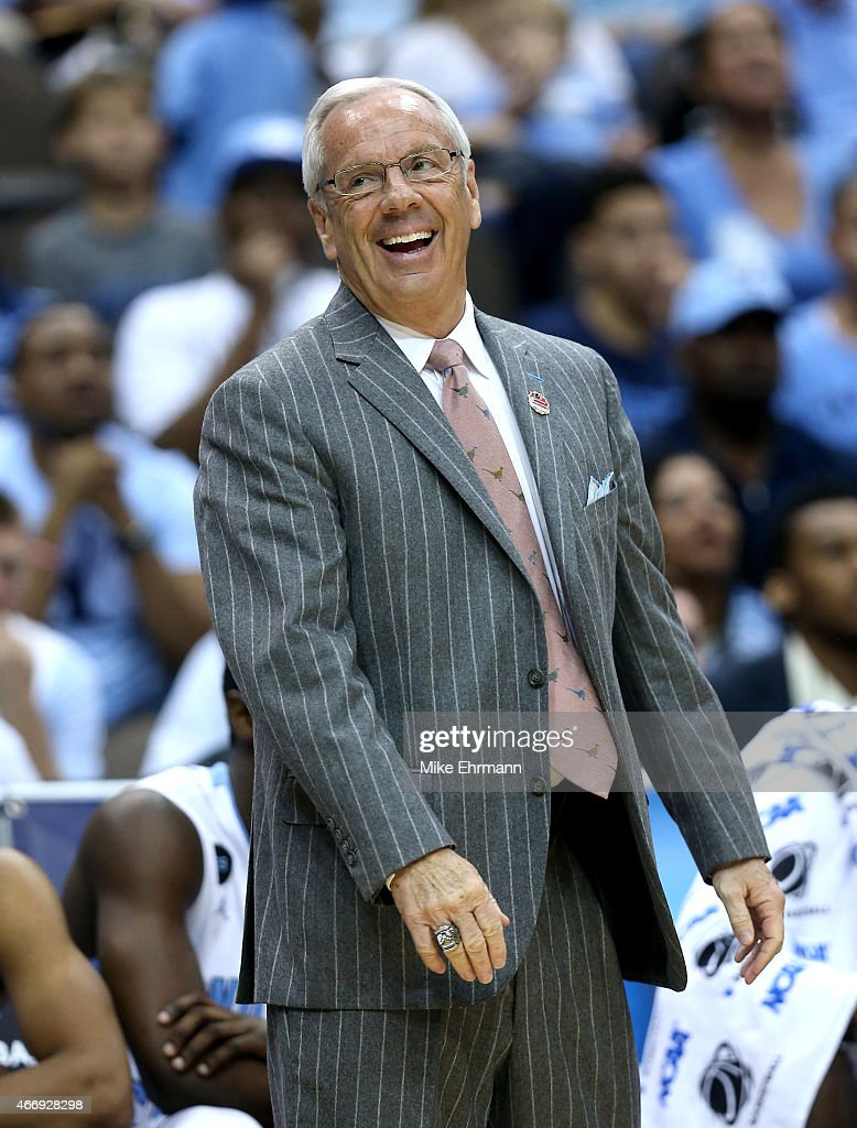 Head coach <a gi-track='captionPersonalityLinkClicked' href=/galleries/search?phrase=Roy+Williams+-+Coach&family=editorial&specificpeople=5086044 ng-click='$event.stopPropagation()'>Roy Williams</a> of the North Carolina Tar Heels reacts after a play against the Harvard Crimson during the second round of the 2015 NCAA Men's Basketball Tournament at Jacksonville Veterans Memorial Arena on March 19, 2015 in Jacksonville, Florida.