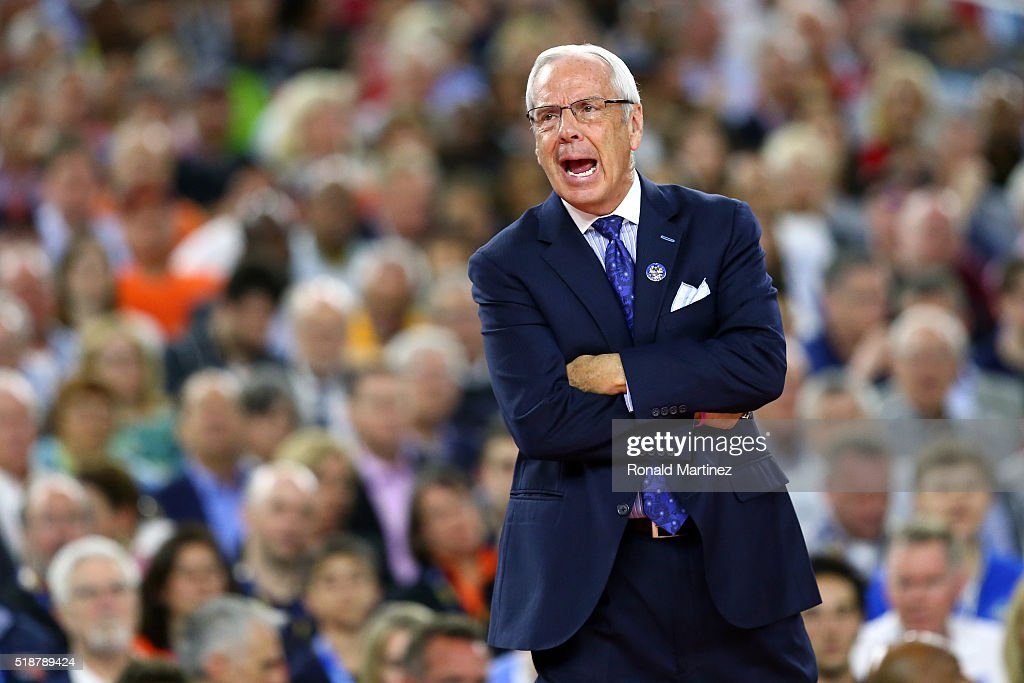 Head coach <a gi-track='captionPersonalityLinkClicked' href=/galleries/search?phrase=Roy+Williams+-+Coach&family=editorial&specificpeople=5086044 ng-click='$event.stopPropagation()'>Roy Williams</a> of the North Carolina Tar Heels reacts in the first half against the Syracuse Orange during the NCAA Men's Final Four Semifinal at NRG Stadium on April 2, 2016 in Houston, Texas.