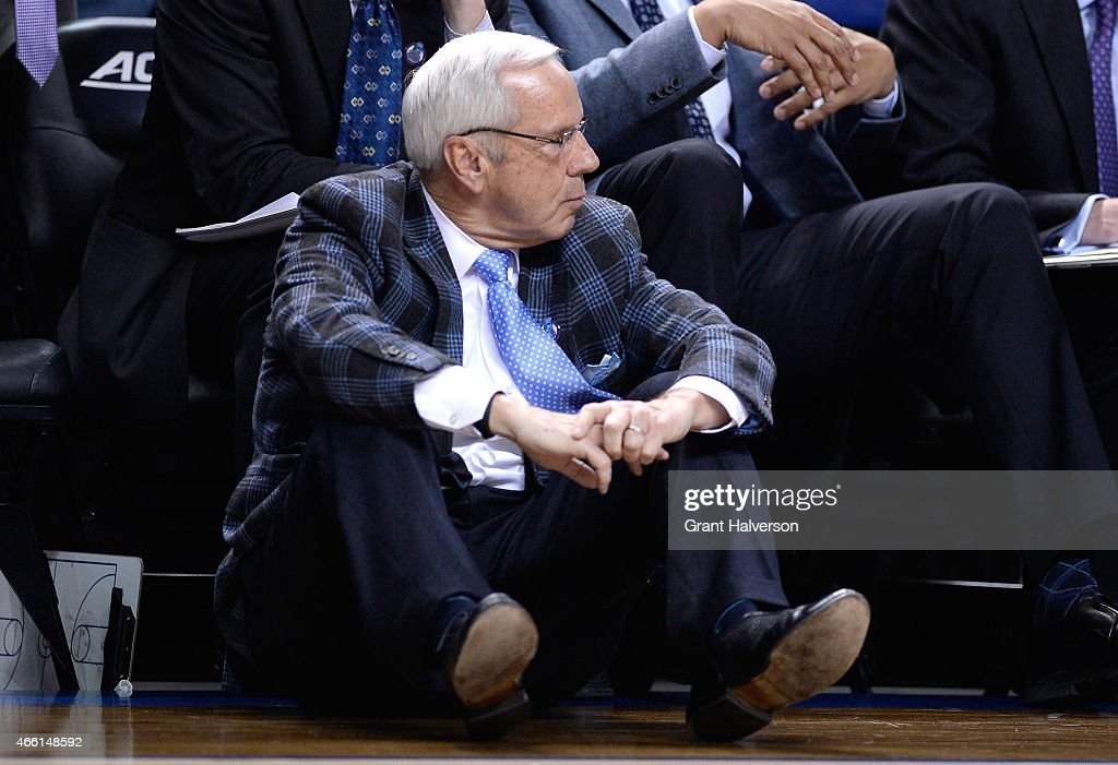 Head coach <a gi-track='captionPersonalityLinkClicked' href=/galleries/search?phrase=Roy+Williams+-+Basketball+-+Entra%C3%AEneur&family=editorial&specificpeople=5086044 ng-click='$event.stopPropagation()'>Roy Williams</a> of the North Carolina Tar Heels reacts against the Virginia Cavaliers during the semifinals of the 2015 ACC Basketball Tournament at Greensboro Coliseum on March 13, 2015 in Greensboro, North Carolina.