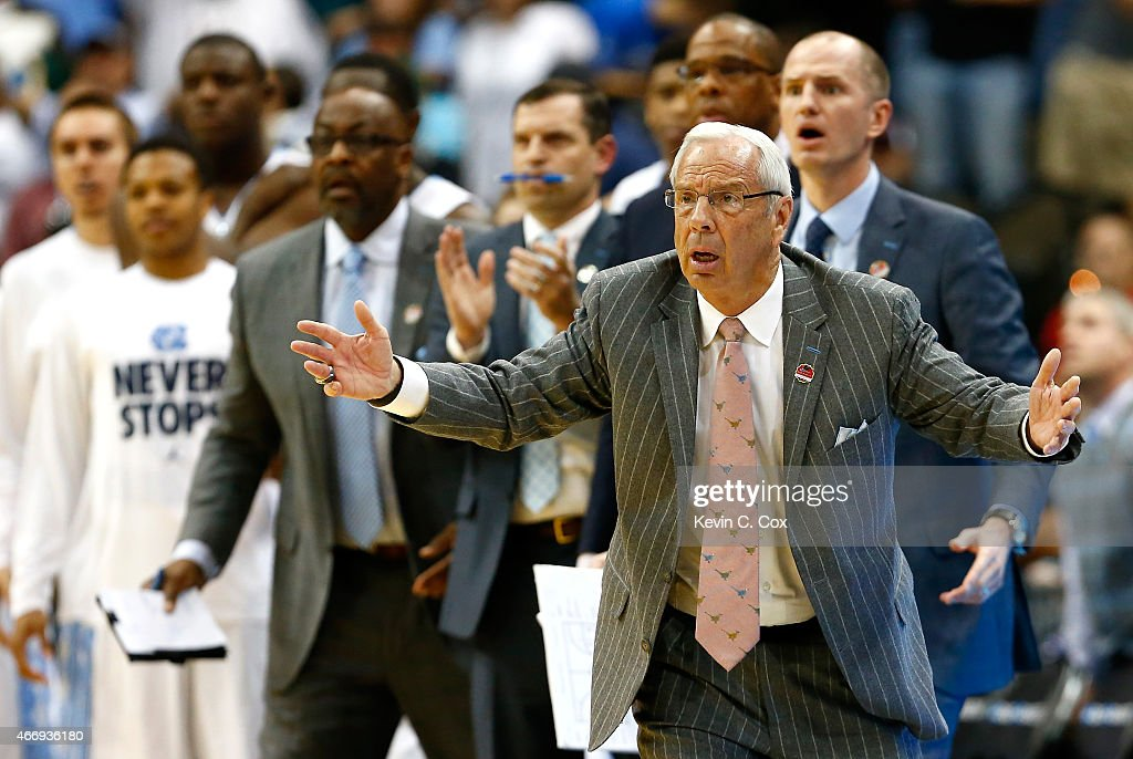 Head coach <a gi-track='captionPersonalityLinkClicked' href=/galleries/search?phrase=Roy+Williams+-+Basketball+-+Entra%C3%AEneur&family=editorial&specificpeople=5086044 ng-click='$event.stopPropagation()'>Roy Williams</a> of the North Carolina Tar Heels reacts against the Harvard Crimson during the second round of the 2015 NCAA Men's Basketball Tournament at Jacksonville Veterans Memorial Arena on March 19, 2015 in Jacksonville, Florida.