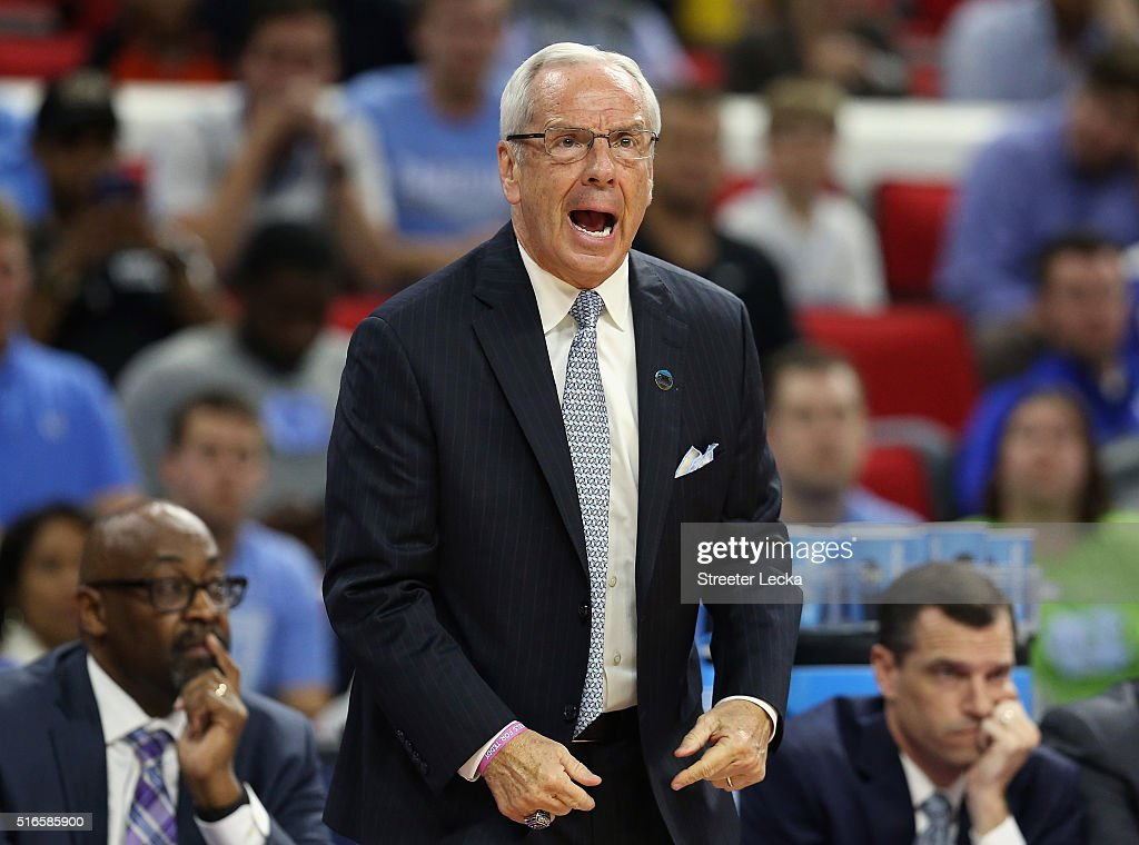 Head coach Roy Williams of the North Carolina Tar Heels reacts against the Providence Friars in the first half during the second round of the 2016 NCAA Men's Basketball Tournament at PNC Arena on March 19, 2016 in Raleigh, North Carolina.