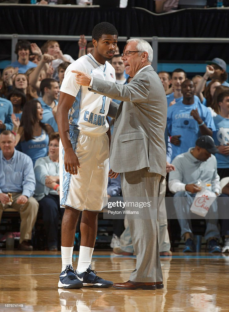 Head coach Roy Williams of the North Carolina Tar Heels speaks with <a gi-track='captionPersonalityLinkClicked' href=/galleries/search?phrase=Dexter+Strickland&family=editorial&specificpeople=5792010 ng-click='$event.stopPropagation()'>Dexter Strickland</a> #1 while playing the Alabama Birmingham Blazers on December 01, 2012 at the Dean E. Smith Center in Chapel Hill, North Carolina. North Carolina won 102-84.