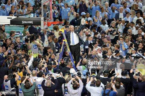 Head coach Roy Williams of the North Carolina Tar Heels takes down the net during the 2017 NCAA Men's Final Four National Championship game against...
