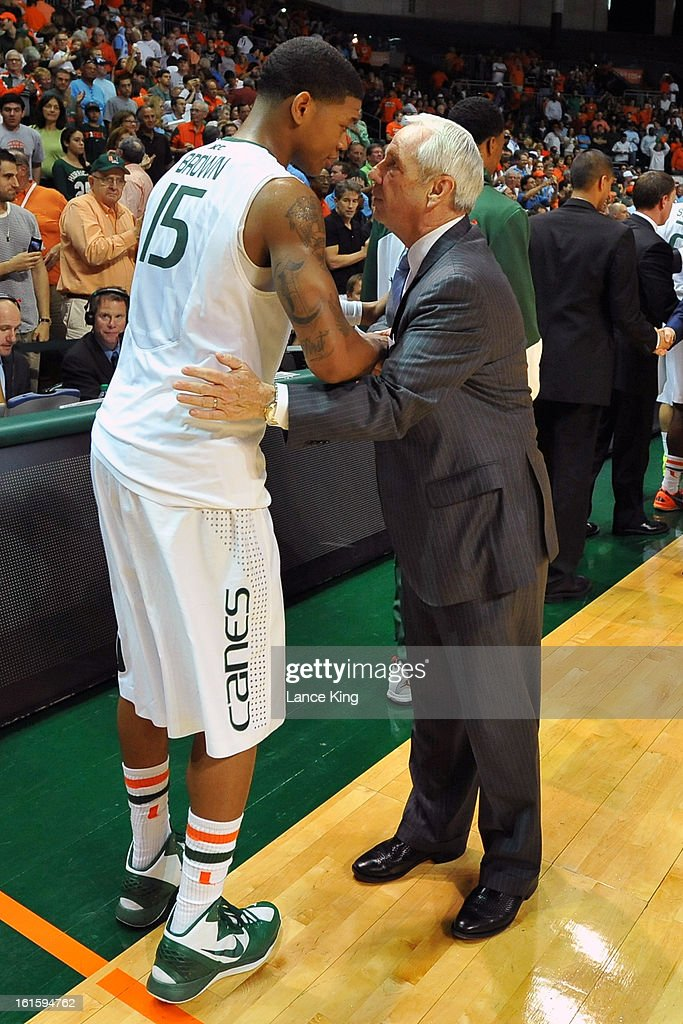 Head Coach Roy Williams (R) of the North Carolina Tar Heels talks with Rion Brown #15 of the Miami Hurricanes following their game at the BankUnited Center on February 9, 2013 in Coral Gables, Florida. Miami defeated North Carolina 87-61.