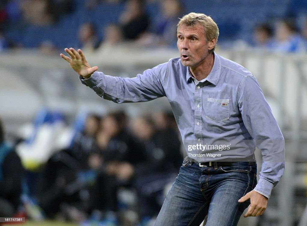 Head coach <a gi-track='captionPersonalityLinkClicked' href=/galleries/search?phrase=Rudi+Bommer&family=editorial&specificpeople=635277 ng-click='$event.stopPropagation()'>Rudi Bommer</a> of Cottbus gestures during the DFB Cup second round match between TSG 1899 Hoffenheim and FC Energie Cottbus at Wirsol Rhein-Neckar-Arena on September 24, 2013 in Sinsheim, Germany.