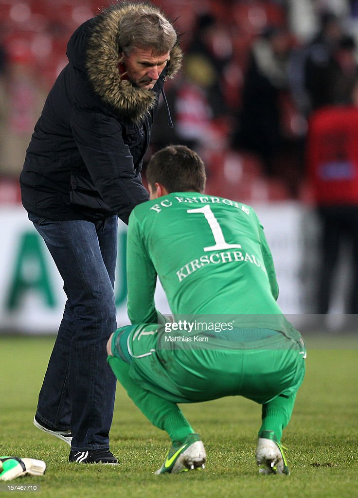 Head coach Rudolf Bommer (L) of Cottbus and Thorsten Kirschbaum (R) show their frustration after loosing the Second Bundesliga match between FC Energie Cottbus and Hertha BSC Berlin at Stadion der Freundschaft on December 3, 2012 in Cottbus, Germany.